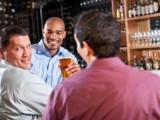 Three men at bar after work