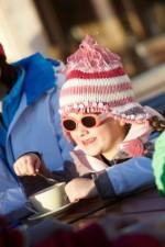 Young Girl Enjoying Hot Drink In Café At Ski Resort